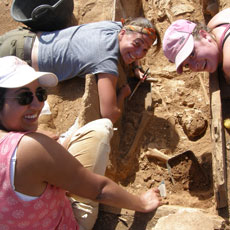 Students digging a Roman tomb