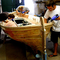 Students learning how to restore a Menorcan boat