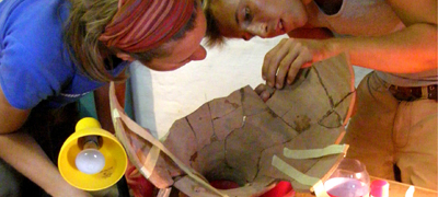Students reconstructing an amphora from the excavation