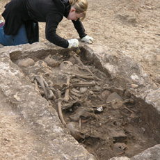 Student excavating a Roman tomb in Siculi