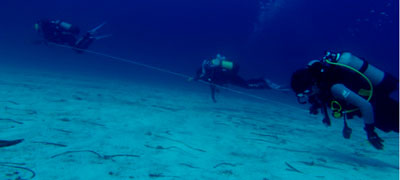 Students of underwater archeology using survey techniques more than 18 meters deep