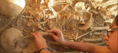 Student working in Sanisera Necropolis